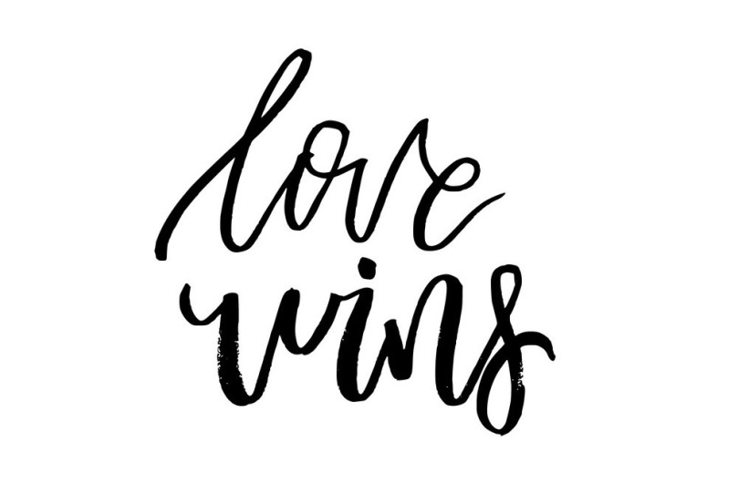 Love Wins - Happy Valentines day card with calligraphy text on w